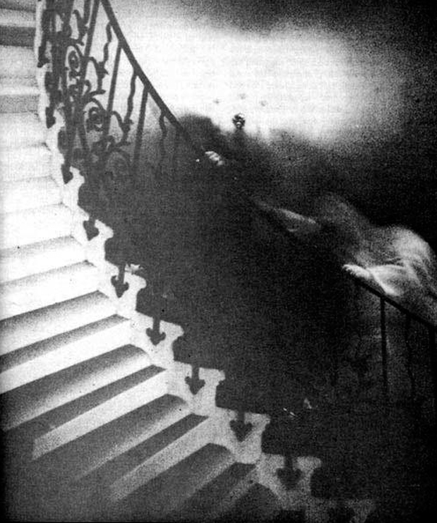 Ghost photo of robed figure ascending the Tulip Staircase at the Martime Museum in Greenwich London