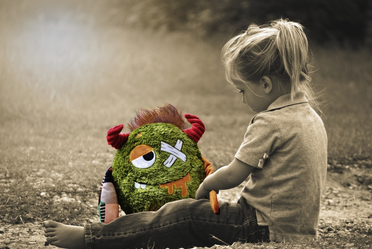 child playing with monster doll